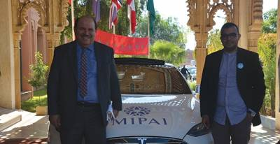 "Mr. Abdellah Boussouf  discovers with Mr. Ayoub Makhloufi, one of the inventors of  « Light us »,   an electric vehicle of the caravan ""Light Us"""